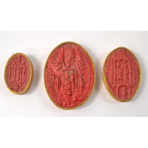 40 - A very old collection of 7 red wax ancient biblical style effigy seals largest dimensions L 6cm x 4....