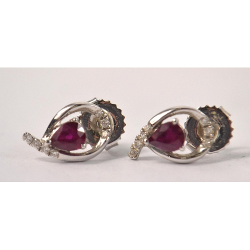 9 - A super quality pair of white gold 18k heart shaped ruby and diamond earrings purchased in Singapore...