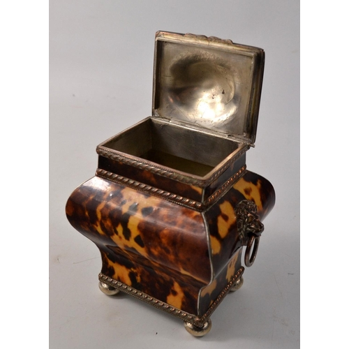 17 - Vintage tea caddy with lion handles and white metal bun feet. With chamois bag...