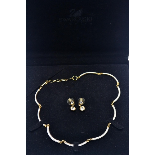 34 - SWAROVSKI presentation cased ladies necklace and matching earrings...