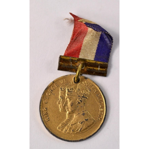 50 - A 1937 Coranation King George V1/Queen Elizabeth medal with ribbon...