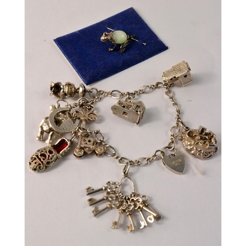 24 - Silver charm bracelet with 10 approx charms and a separate moonstone set frog charm...