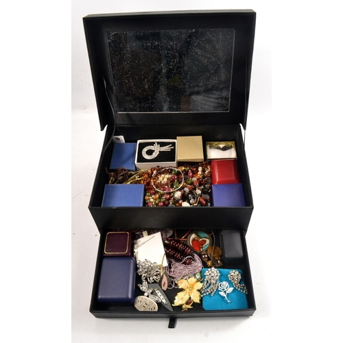 38 - Large black jewellery box with selection of costume jewellery...