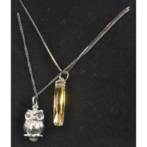 16 - 2 925 Stamped Silver Pendants and chains. one depicting a Owl the other a piece of crystal<br>#43...