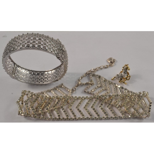 18A - A small collection of BLING jewellery to include a lovely necklet and a white metal snap-shut bangle...