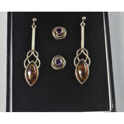 8 - Two pairs of 925 Stamped Silver earring 1 set with amber style stones, other pair with Knot design s...