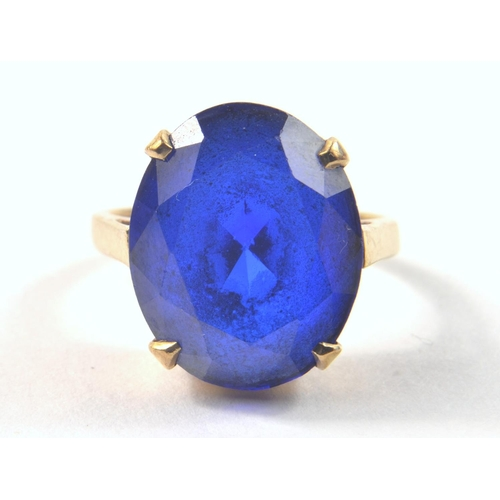 1B - 9ct Stamped Yellow Gold Ring set with large blue oval cut stone. [ ? Tanzanite ] stone is 1.5cm x 1....