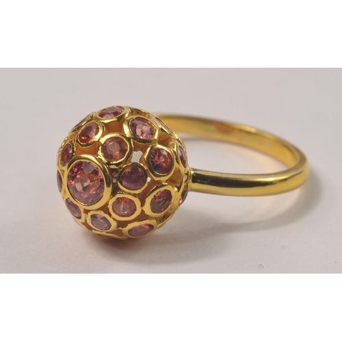 2A - UNUSUAL! 750 stamped small pink sapphires encrusted and one larger centred sapphire inset within a s...