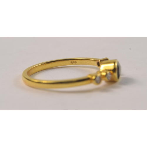 2G - A 585 stamped yellow gold ladies ring size M/N with a large TOPAZ setting with four small white diam...