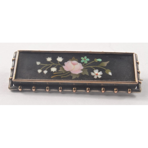 3D - Lovely vintage Black based Floral designed Micro Mosaic bar brooch, set in a white with gold highlig...