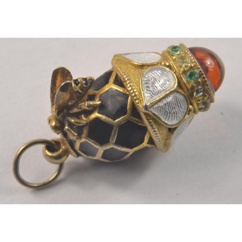 4C - Lovely Miniature FABERGE styled egg, charm/ pendant set with a small bee on side and a red stone at ...