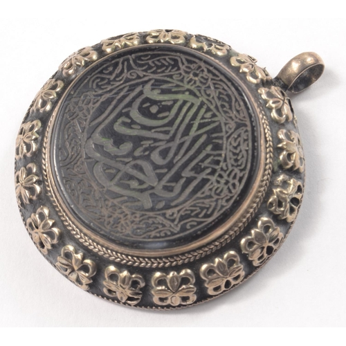 4F - Large Circular White Metal pendant set with centre black stone with Arabic inscription, possibly a s...