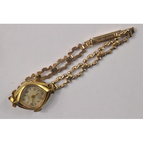 7 - A 375 vintage cased ladies watch, glass loose, and second hand missing, gross weight 28.7g, also a 9...