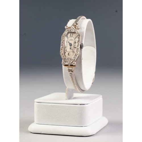 16 - LADY'S UNO SWISS WRIST WATCH, with 17 jewels movement, narrow oval silvered Arabic dial, in 18ct whi...