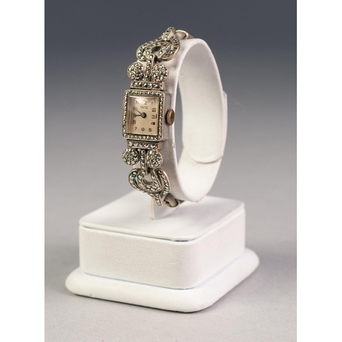21 - LADY'S 'ORMO' RHODIUM PLATED AND MARCASITE COCKTAIL WATCH with small silver oblong Arabic dial, fanc...