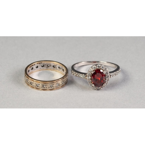 56 - 9ct GOLD ETERNITY RING set with tiny diamonds, 2.5gms and a COSTUME CLUSTER RING (2)...