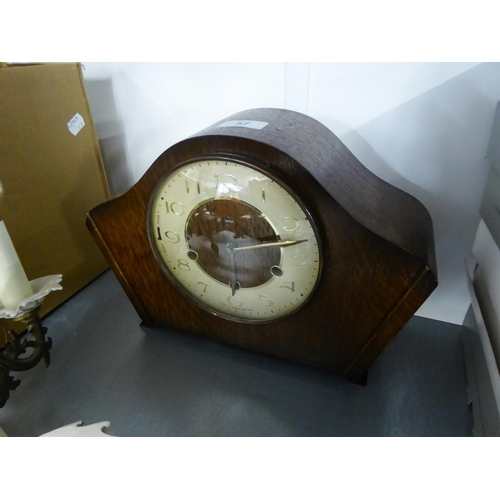 57 - 1950's SMITHS OAK CASED MANTLE CLOCK, in an arch top case, striking on four rods...