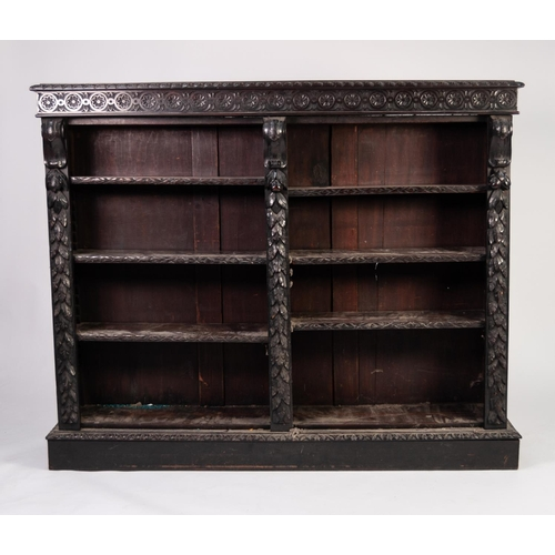 49 - LATE NINETEENTH CENTURY CARVED DARK OAK OPEN BOOKCASE, the moulded top above a frieze carved with fl...
