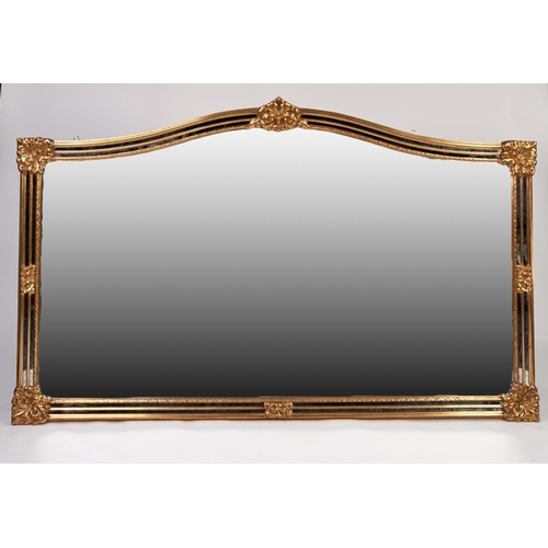44 - LARGE MODERN GILT FRAMED WALL MIRROR, the arch topped oblong plate housed in a moulded frame with mo...