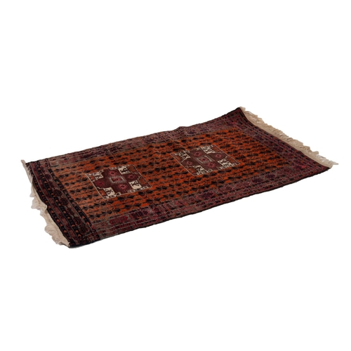 1 - BALUCHI AFGHAN NOMADIC RUG, with two large rectangular medallions on an old gold field with all-over...