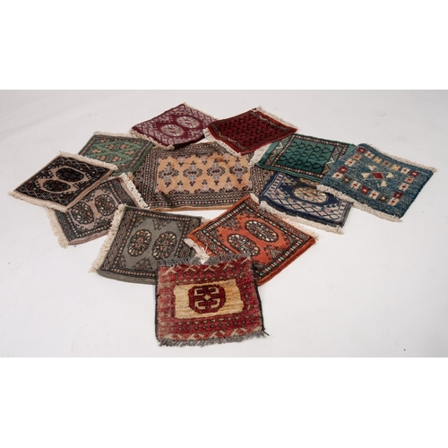 3 - PAKISTAN BOKHARA SMALL BORDERED RUG with repeat pattern on gold field 1'10