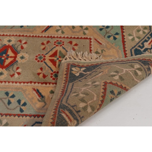 5 - MODERN INDIAN WOOL PILE LARGE RUG with narrow central panel with five medallion pattern and having t...