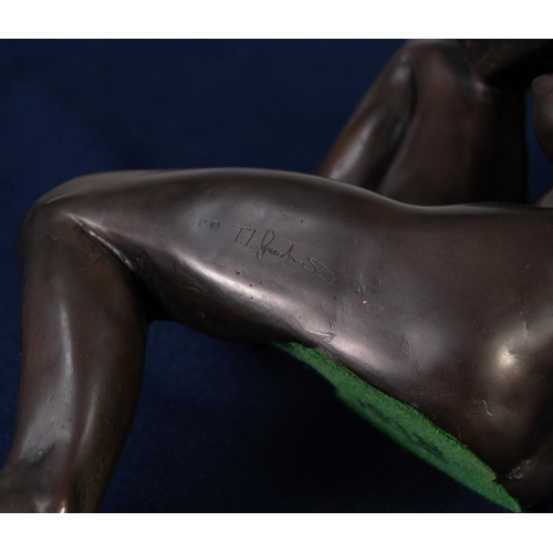 24 - TOM L GREENSHIELDS MODERN COLD CAST BRONZE NUDE FEMALE FIGURE in open seated pose one leg dangling a...