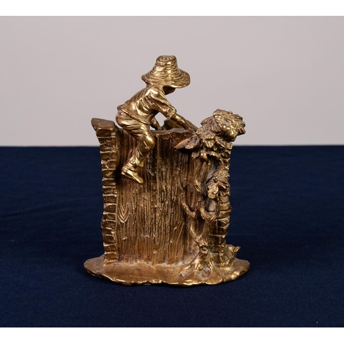 32 - 20th CENTURY HEAVY CAST BRASS GROUP depicting two boys scaling a rustin gateway bull dog lying beloe...