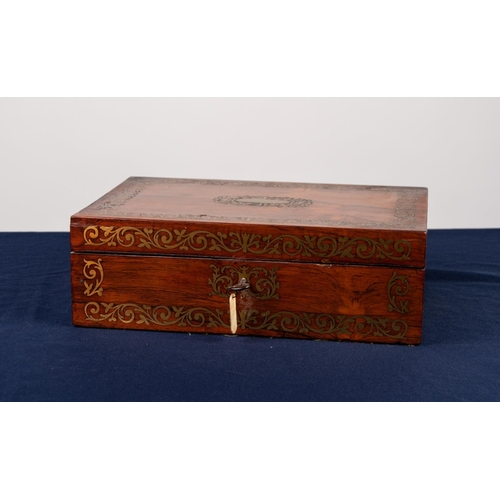 16 - REGENCY ROSEWOOD PORTABLE WRITING BOX with elaborate cut brass foliate borders to the top and front,...
