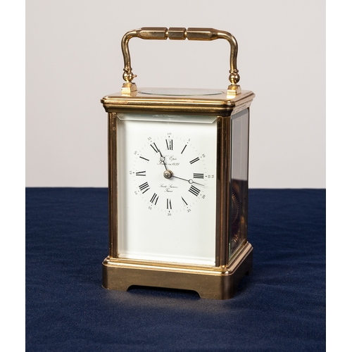 12 - A POST WAR FRENCH CASED CARRIAGE CLOCK the white enamel dial inscribed