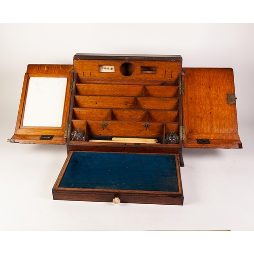 19 - A LATE VICTORIAN OAK SLOPING FRONT PORTABLE DESK, with sunk brass carrying hands, 17 1/4