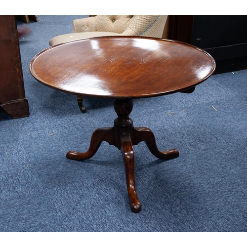55 - LATE GEORGIAN MAHOGANY REVOLVING TRIPOD OCCASIONAL TABLE, the slightly dished top with birdcage supp...