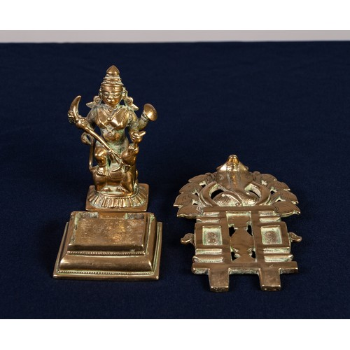 26 - 19th CENTURY HINDU CAST BRASS SMALL PORTABLE FIGURE OF A FEMALE DEITY WITH FOUR ARMS one foot raised...