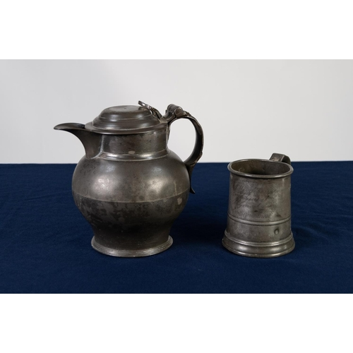 29 - ANTIQUE PEWTER BULBOUS BEER JUG the hinged domed lid with pierced thumb piece on stepped circular fo...