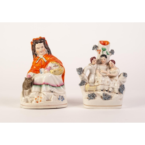 10 - NINETEENTH CENTURY STAFFORDSHIRE POTTERY FIGURE OF LITTLE RED RIDING HOOD, painted in colours and ty...