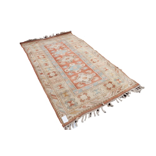 5 - MODERN EMBOSSED SAMARKAND PASTEL COLOURED RUG, with a row of diamond shaped medallions on the narrow...