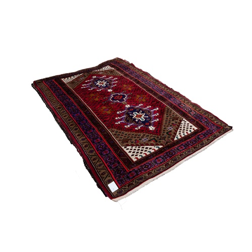 7 - BRIGHTLY COLOURED MODERN DAGHESTAN RUG, with two large geometric medallions and having secondary med...