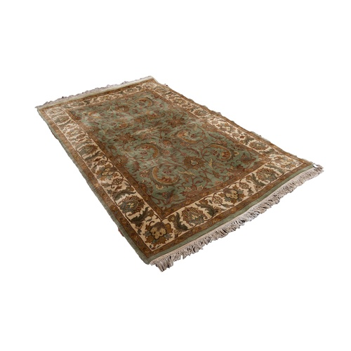 11 - KASHAN PATTERN PERSIAN RUG, with all-over Harati design of flowers and foliate scrolls in gold and g...