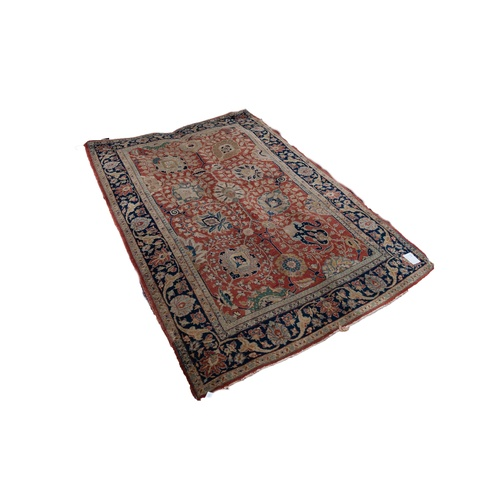 18 - SEMI ANTIQUE KASHAN RUG, with an all-over design of delicate foliate scrolls with large formal flora...