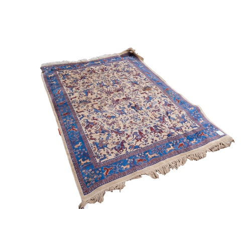26 - MACHINE WOVEN TAPESTRY HUNTING RUG OR WALL HANGING, with an all-over decoration of equestrian figure...