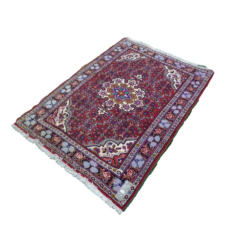34 - BIJAR, PERSIAN RUG with large octafoil medallion with pendants on white background, matching spandre...