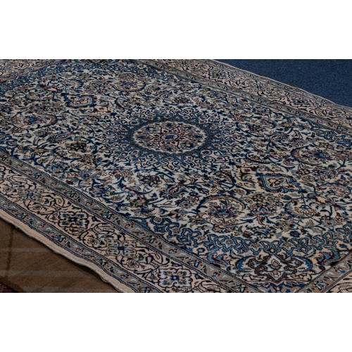 35 - GOREVAN, PERSIAN CARPET with circular concentric medallions with long pendants, on a white field wit...