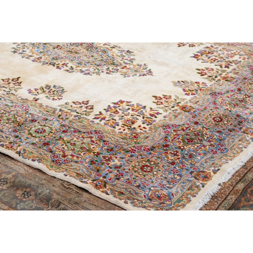 36 - GOREVAN PERSIAN CARPET with concentric lozenge shaped terra cotta, pale blue and floral medallions w...