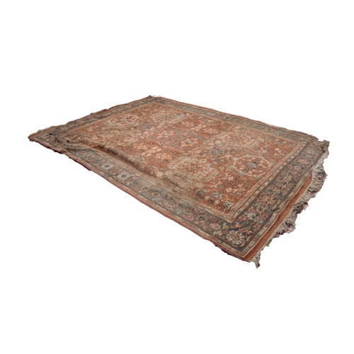 43 - LARGE EASTERN CARPET with central medallion and six large radiating floral medallions on the brick r...