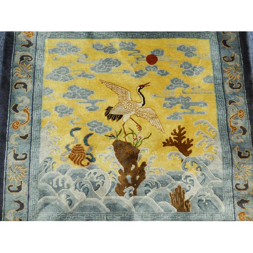 44 - CHINESE PART SILK PICTORIAL RUG OR HANGING, depicting a crane flying off a rock amidst waves, the re...