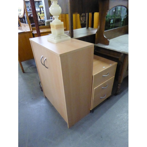 218 - A MODERN LIGHTWOOD TWO DOOR CUPBOARD AND A MATCHING THREE DRAWER BEDSIDE CUPBOARD (2)...