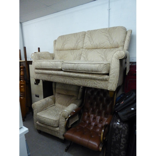 221 - A MODERN TWO PIECE LOUNGE SUITE, CONSISTING; A THREE SEATER SETTEE AND AN ARMCHAIR, COVERED IN CREAM...