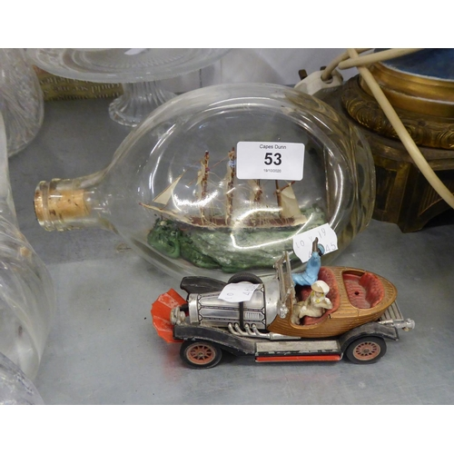 53 - A SHIP IN A BOTTLE AND CORGI TOY 'CHITTY CHITTY BANG BANG' DIE CAST TOY CAR WITH TWO FIGURES (AS FOU...
