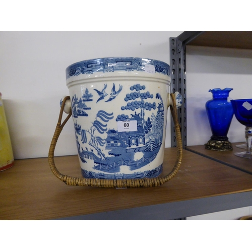 60 - POTTERY WILLOW PATTERN SLOPS PAIL WITH CANE BOUND SWING HANDLE...