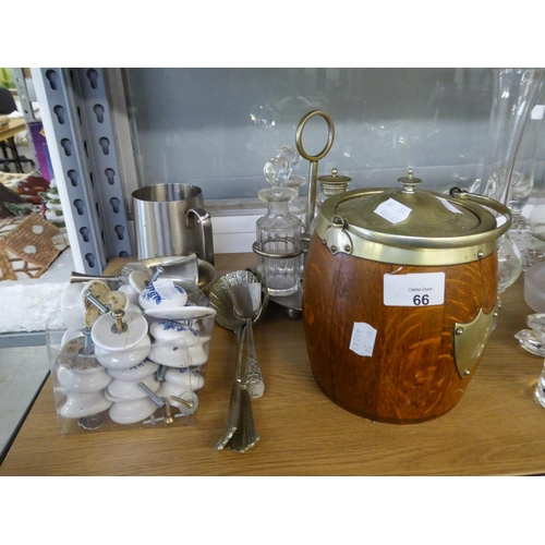 66 - AN OAK BISCUIT BARRELL WITH METAL MOUNTS AND LID; AN ELECTROPLATE CRUET FRAME WITH FOUR CUT GLASS CO...